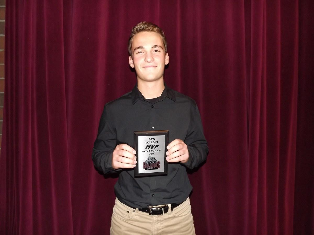boy with tennis MVP award