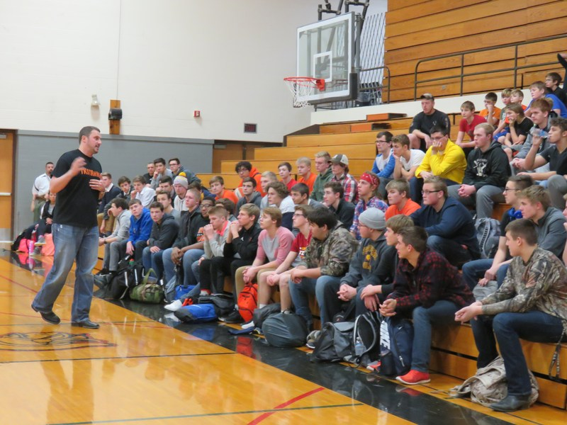 New TK varsity football coach and special education teacher Charlie Feller talks with high school and middle school students.