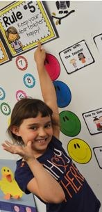 kindergarten student points to class rules