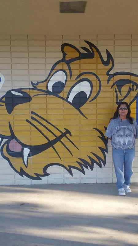 Lolly Ortega in front of the Whittier sign