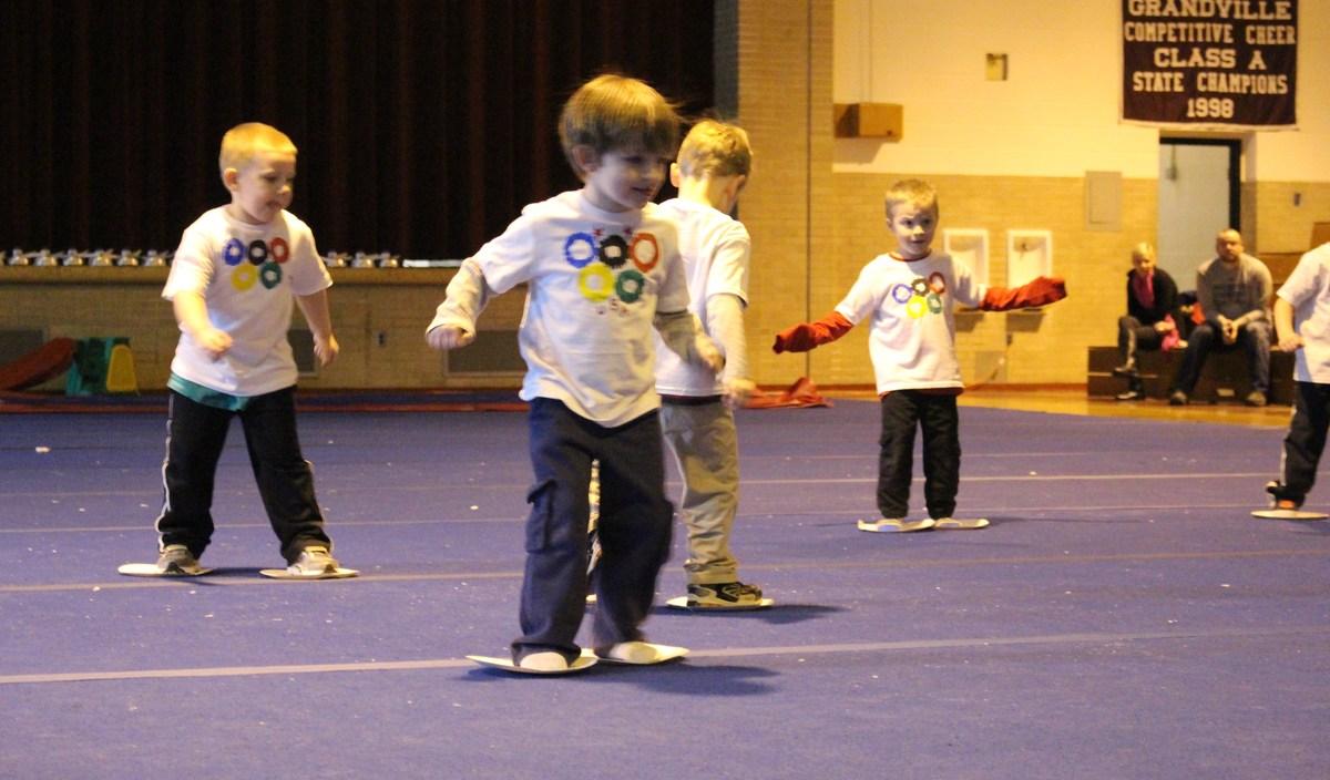 kids skating on cardboard