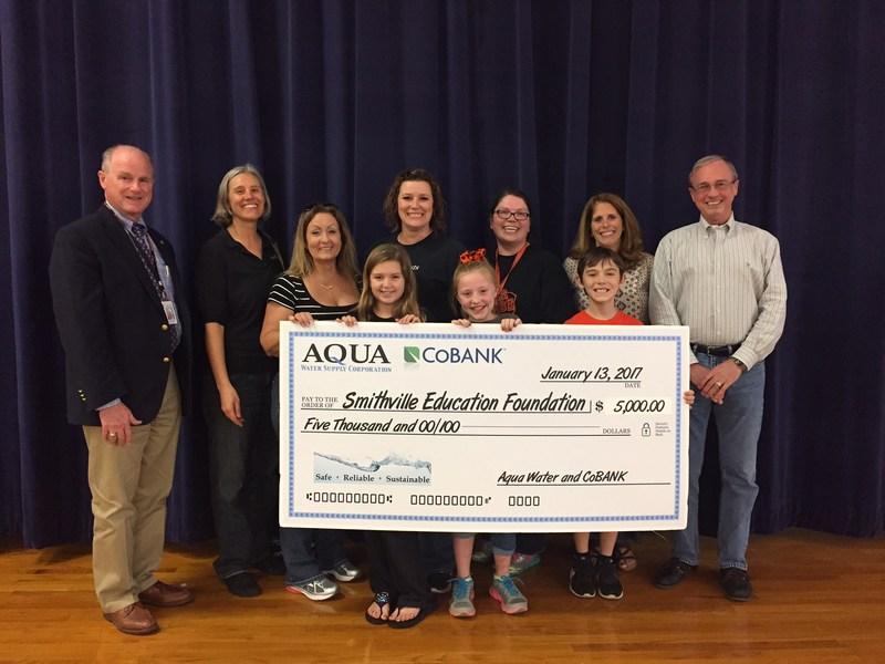 Aqua Water Presents Check to Education Foundation Thumbnail Image