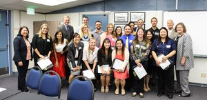 Newly-credentialed teachers posed for a picture with district cabinet and Board members after receiving their official certification.