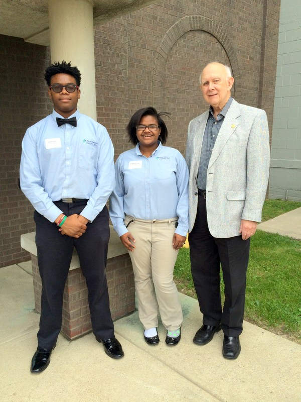 Al Leighton, treasurer, Marian Inc. and students Dionte Dopsom & Chyann Hunter welcome guests to this year's CWS supervisor luncheon.