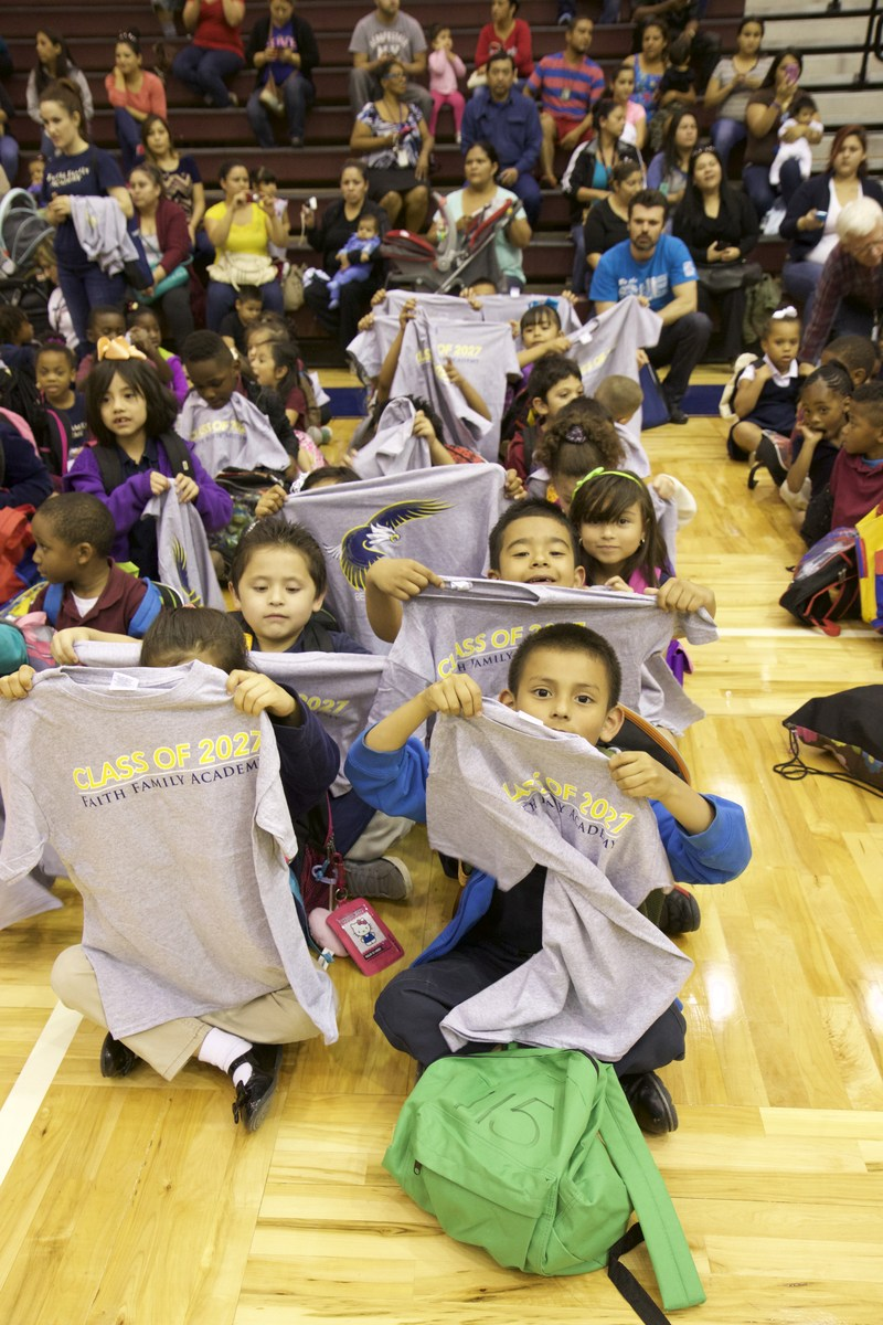 Oak Cliff Faith Family Academy's Class of 2015 Hands Out Shirts to Pre-K & Kinder Students