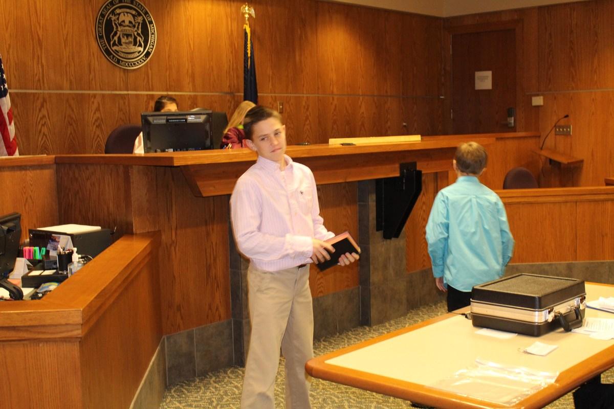 boy in mock court
