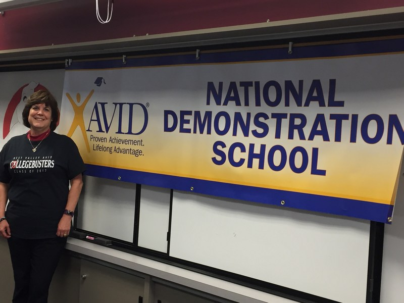 Donna Parker in front of the AVID banner