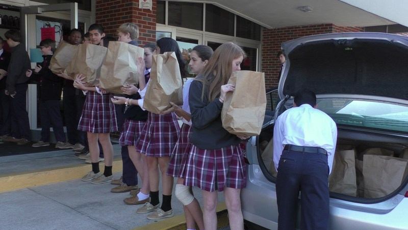 Students & faculty provide Thanksgiving feasts for parish families Thumbnail Image