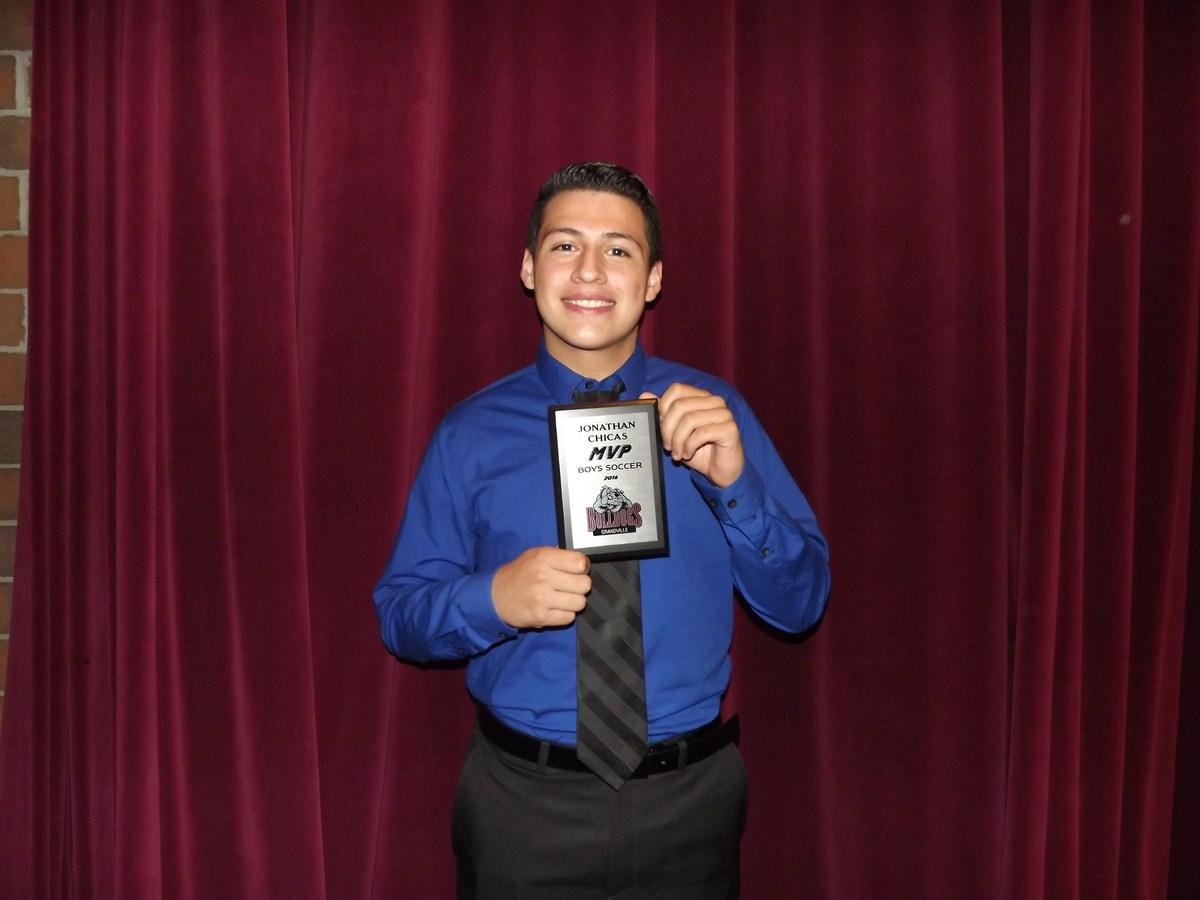 boy with soccer MVP award