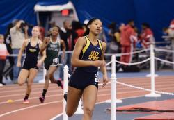 ASIA YOUNG Breaks School Record