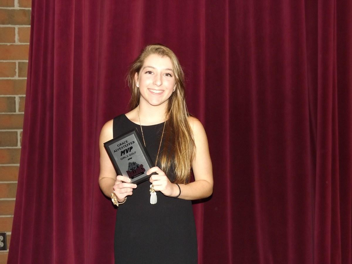 girl with MVP award