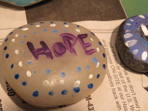 Students painted rocks for Hospice patients as part of the service learning day.