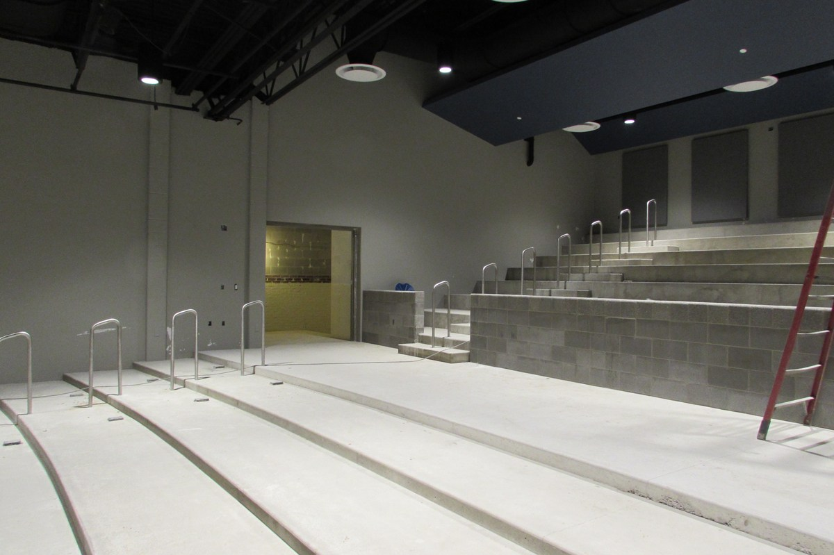 Renovating the auditorium with stadium seating.