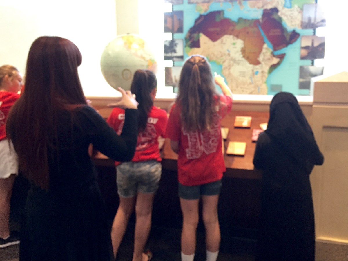 Students doing a scavenger hunt at the Arab American Museum in East Dearborn with Holbrook School