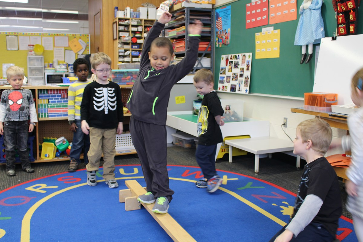 boy on balance beam