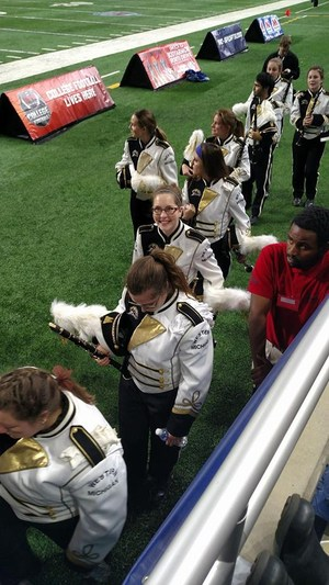 Heather price comes off the field after a performance with the WMU band.