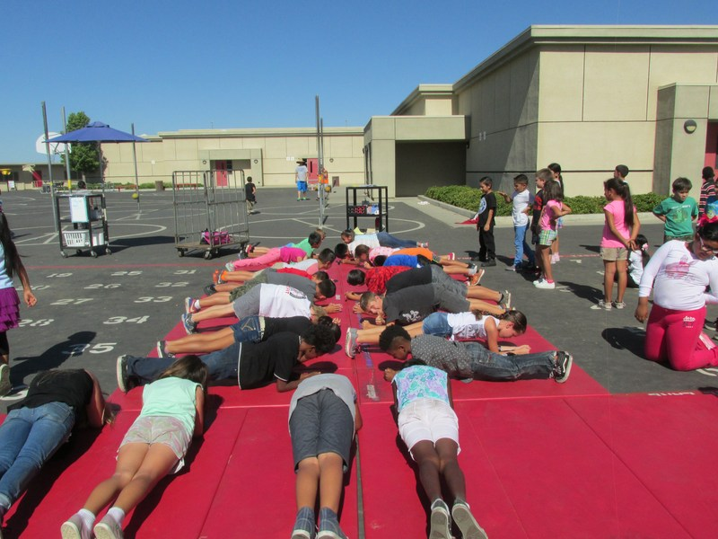 Students planking during their fitness exercise