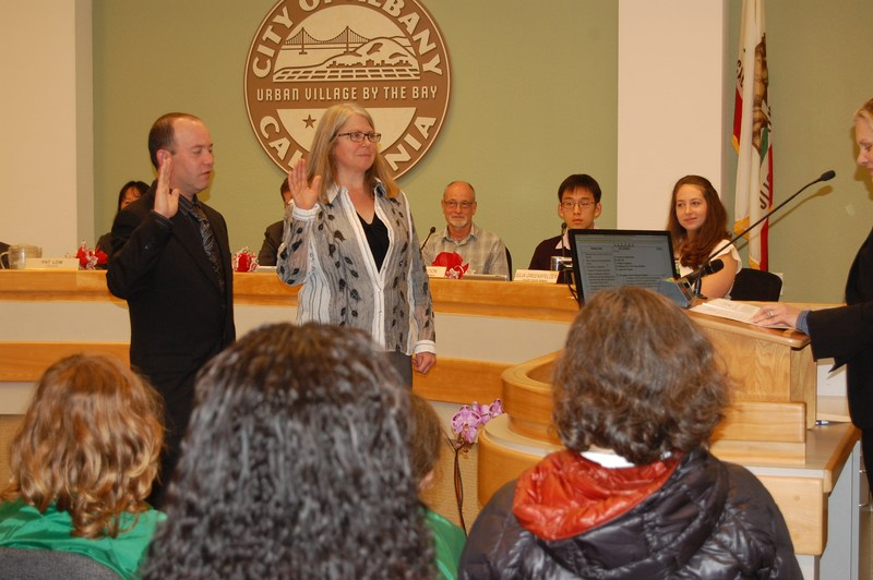photo of Board Trustees Jacob Clark & Kim Trutane, were being sworn in at the 12/13/16 Board of Education meeting.