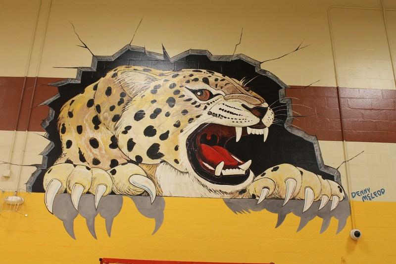 WAHS Gym Has Fresh Paint Job-Local Artist Denny McLeod Paints Jaguar Mural