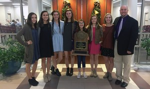 From left, Morgan Ouellette, Anna Waldecker, Camille Smith, Abby Graves, Kerrigan Walls, Taylor Cuneo, Emma Harris and coach Allen Nichols show off their trophy for winning the 2016 State Cross Country Championship for Division I Class A-AA.