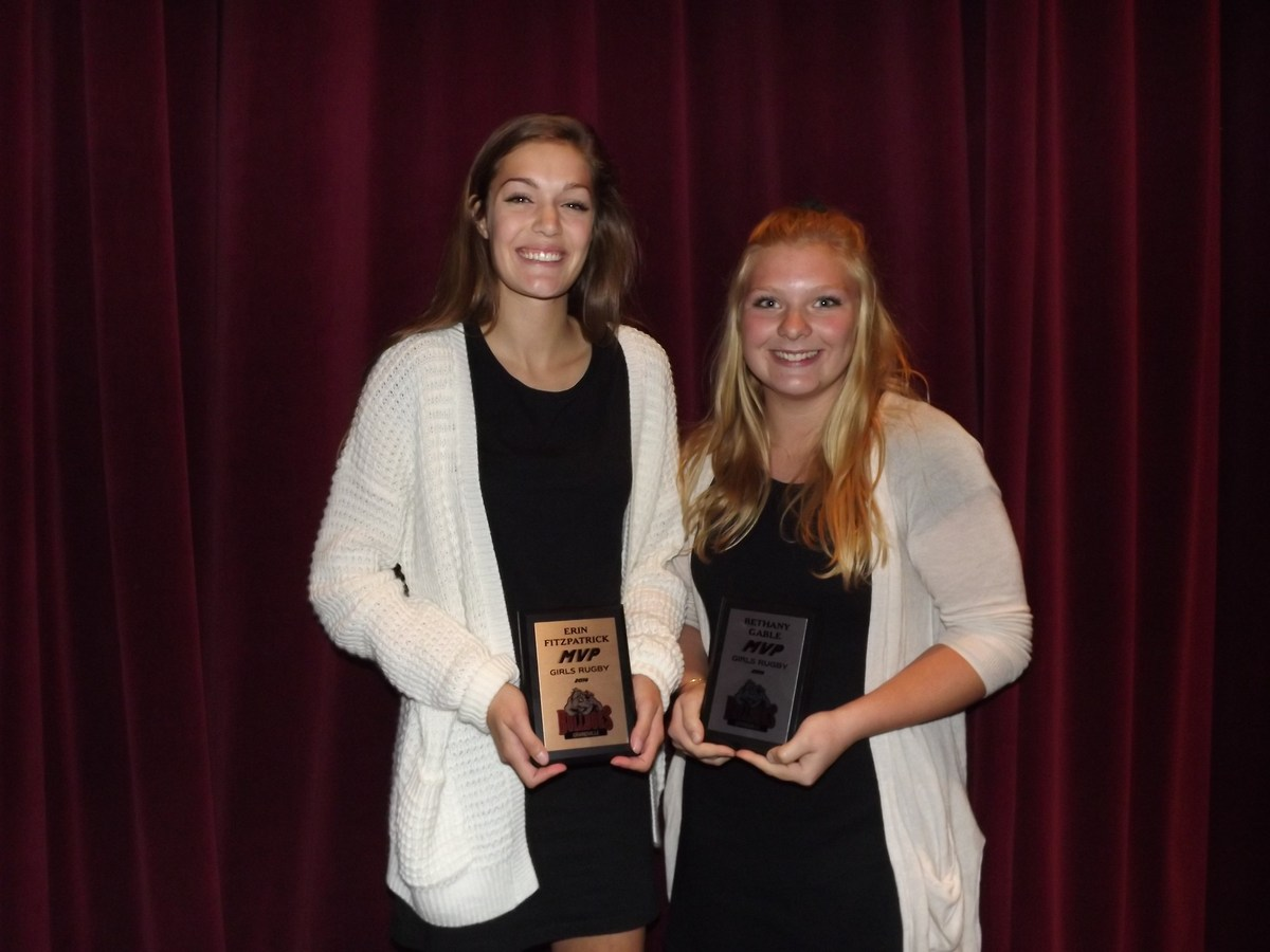 girls with rugby MVP award