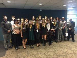 15 business students wear their medals proudly at Ferris State