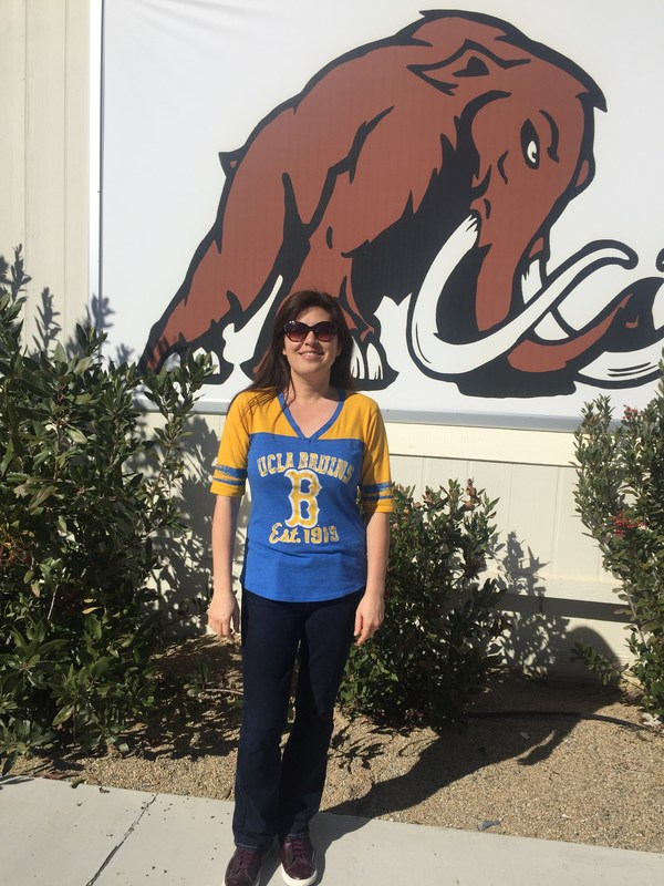 Amy Noizumi in front of the Western Center Academy Mammoth.