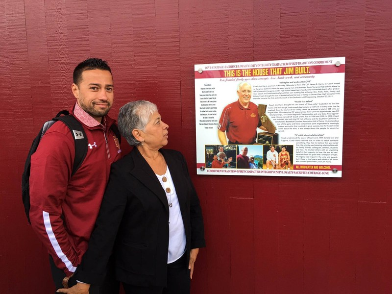Coach Jim Harris' wife and son share a moment together as they celebrated their beloved father's life at the Ocean View High School gymnasium renaming.