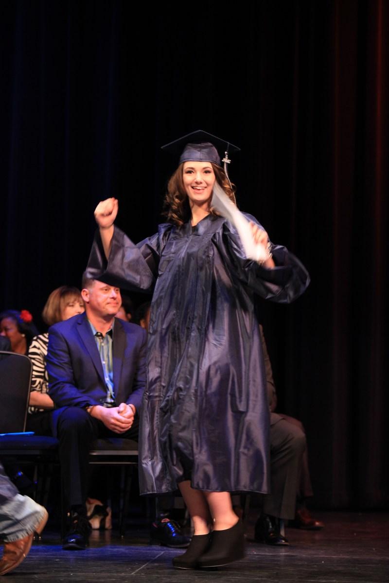 Genesis HS graduates cross stage