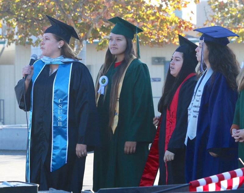 Aida Sandoval and recent high school graduates.