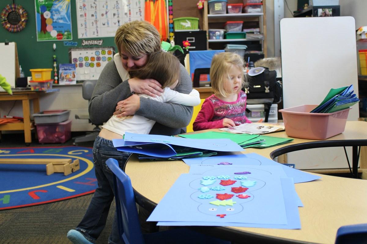 teacher hugs student