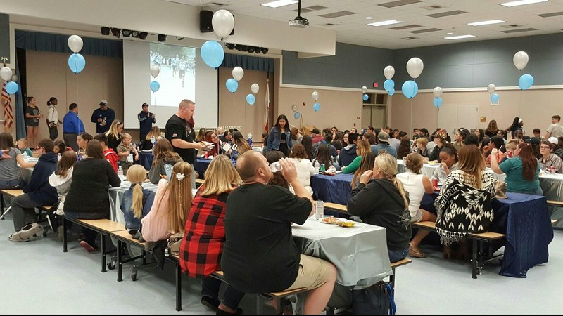 Families and students at Rancho Viejo's fall sports banquet.