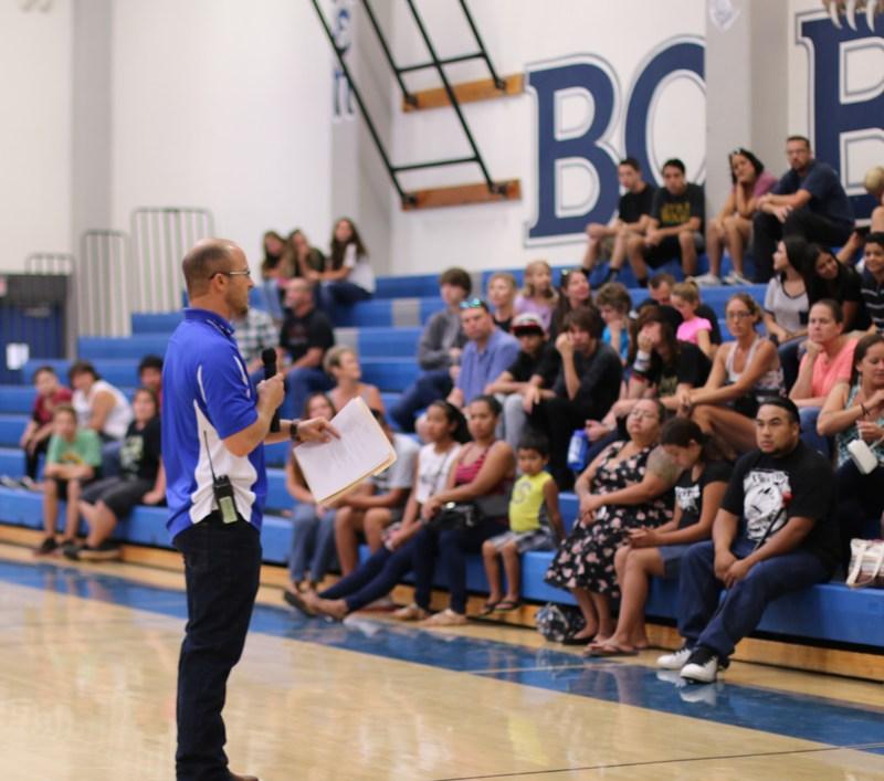 Assistant Principal Daniel Betts talking to new students.
