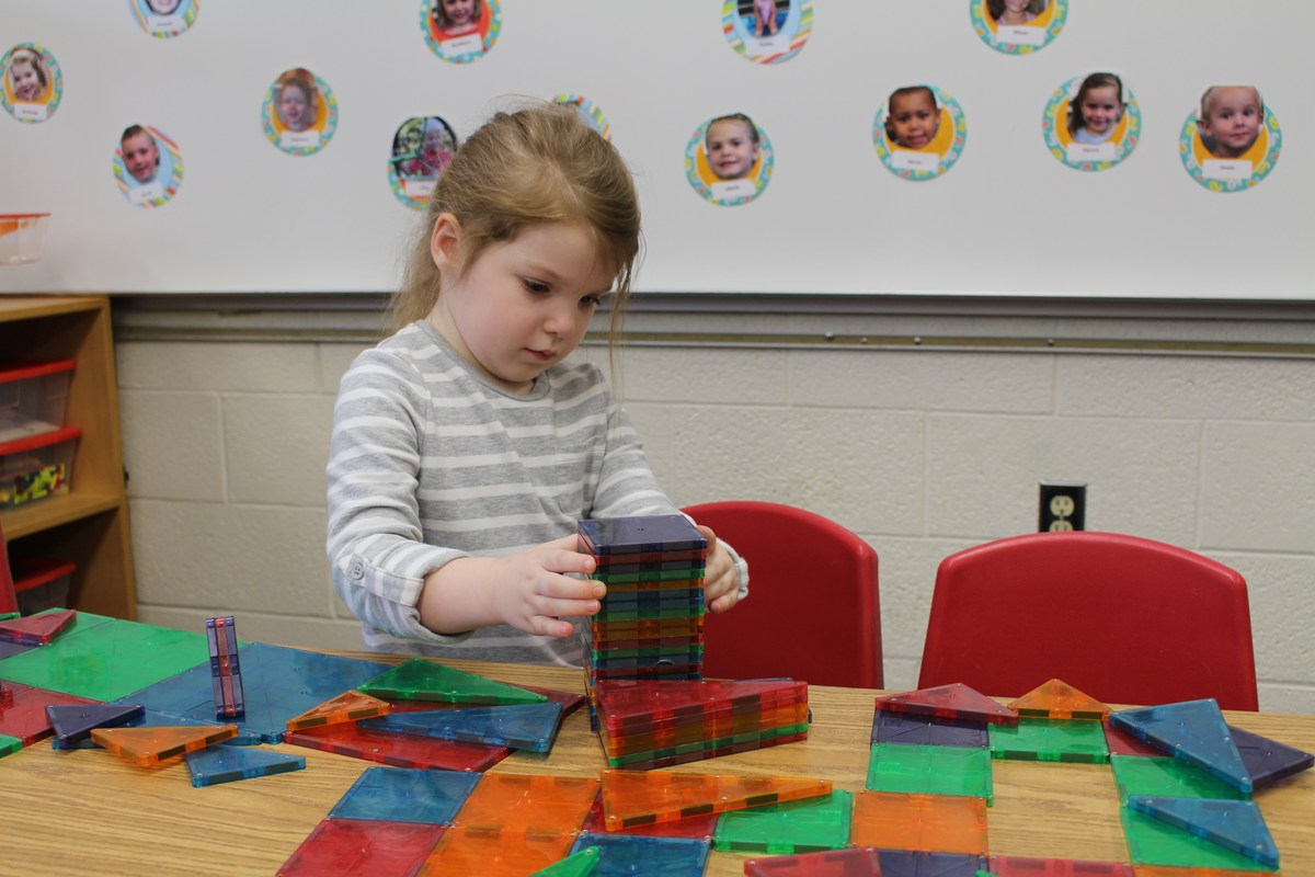 girl building with toys