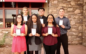 Isabel Michel, Russell Collins, Aleea Moore, Eduardo Zul, Stephanie Avila, and Clayton Ellis holding their Students of the Month plaque