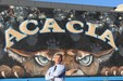 Anthony Blake standing in front of an Acacia sign.