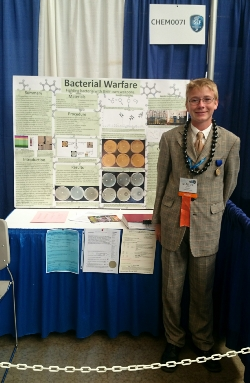 Samuel Scott gives a practice demonstration on his project Bacterial Warfare during the Intel International Science and Engineering Fair at the David L. Lawrence Convention Center