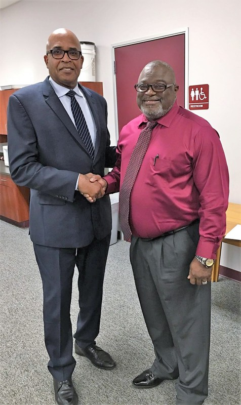 Dr. Johnson congratulates Coach Sargent
