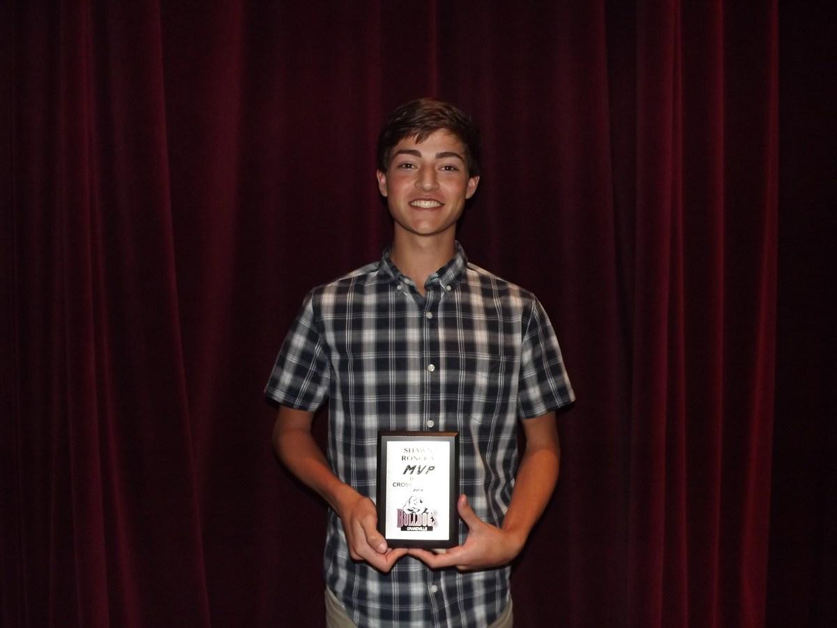boy with MVP award