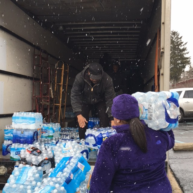 DEA Delivers Water to Two Flint Charter Schools