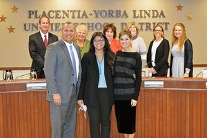Board honors two students for exemplary extra-curricular achievements