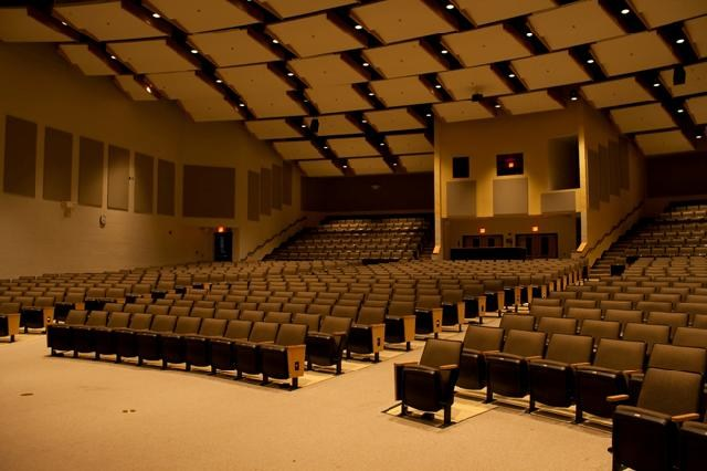 Interior of the Performing Arts Center auditorium as viewed from in front of the stage