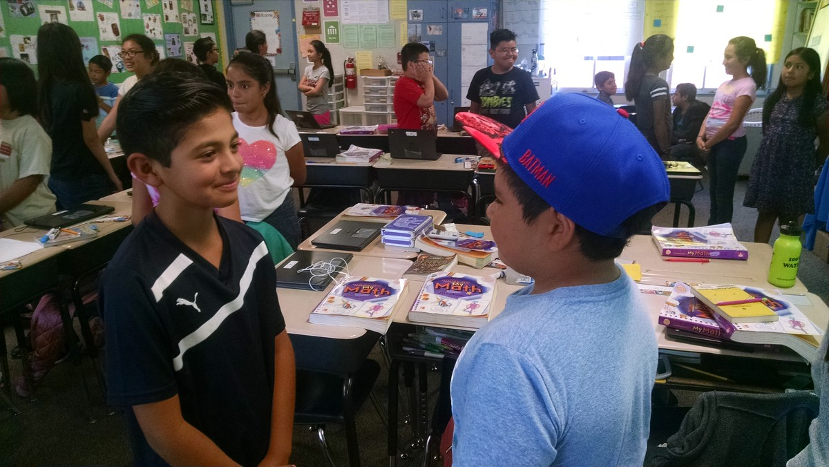 Students are pair-sharing.