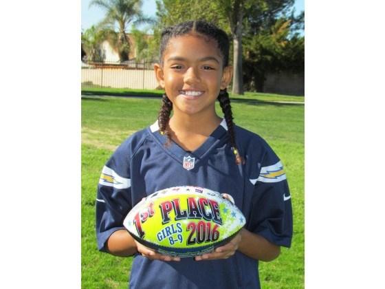 Keyera holding her 1st place trophy for NFL PP&K