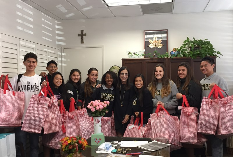 Concordia Club students display Christmas gift bags for children of orphanage in Sonora, Mexico