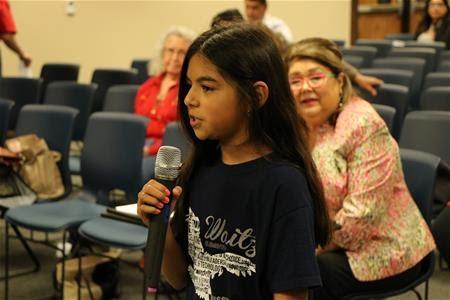 Jade Rodriguez addressing Commissioners Court