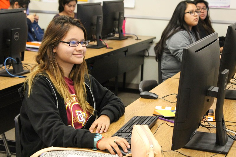 A proud Ocean View High School student smiles as she submits a college application.