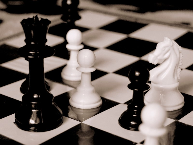 Shows chess pieces on a chess board