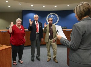 Stacey Bailey, Gene Hikel, and Patrick Searl being administered the Oath of Office by Superintendent Christi Barrett.