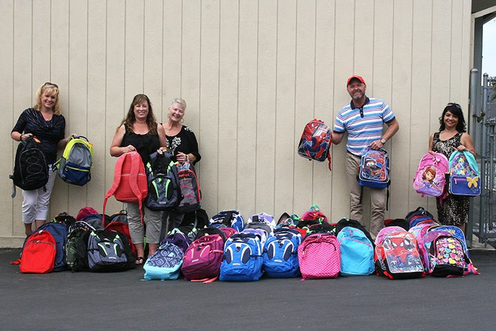 Local church makes generous contribution to school district's most underprivileged kids